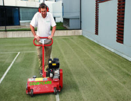 Lifting flat turf and loosening compacted sand base
